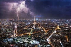 Stormy day in Paris with lightnings over the Eiffel Tower and Paris from Montparnasse tower at night