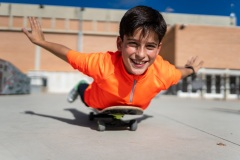 Young boy having fun with skateboard in a park